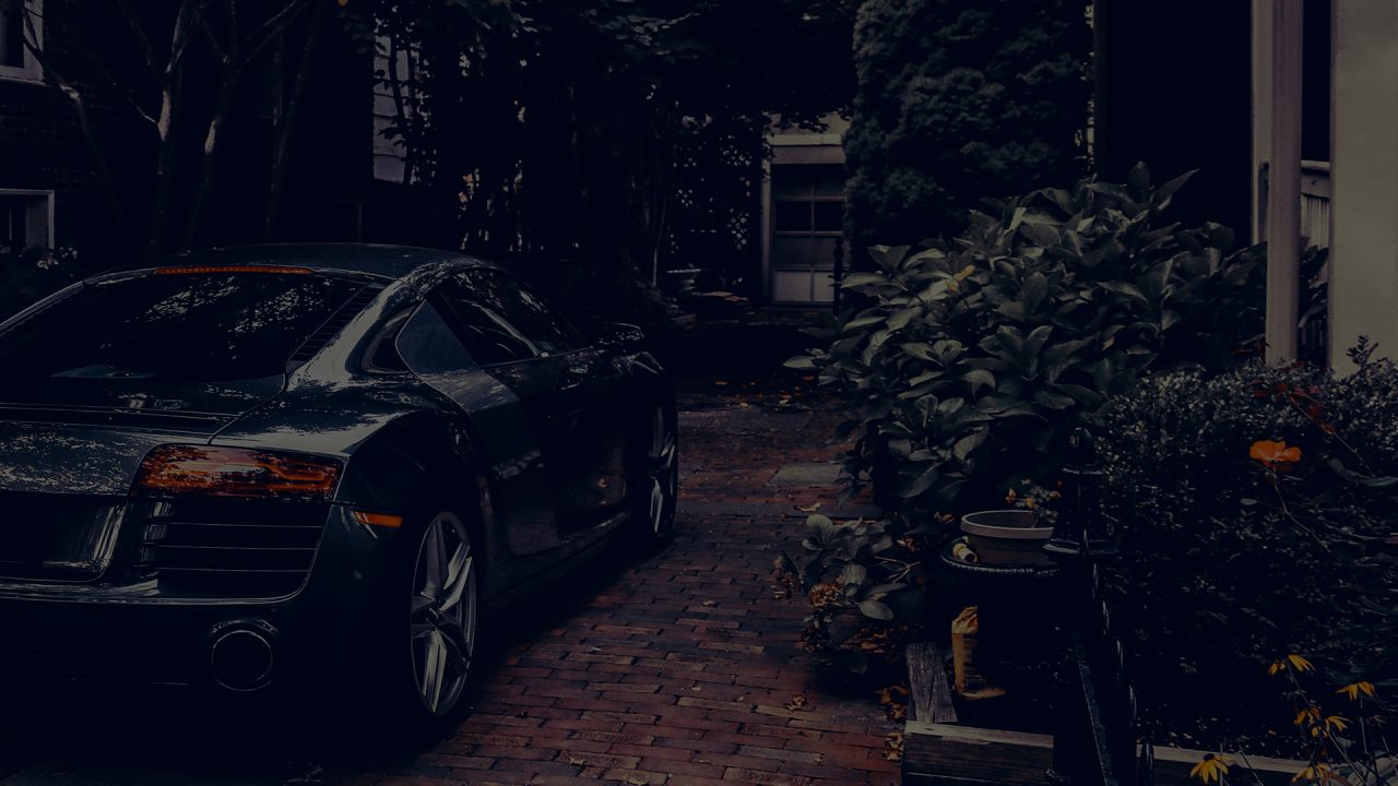 Audi R8 sports car parked on a driveway